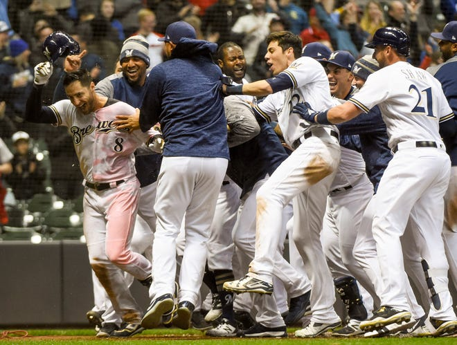 Milwaukee Brewers left fielder Ryan Braun (8) celebrates after hitting a walk-off game-winning home run in the ninth inning against the St. Louis Cardinals at Miller Park.