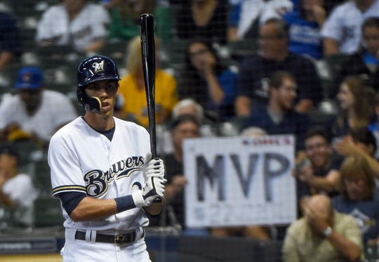 Fans show their support for  Christian Yelich.