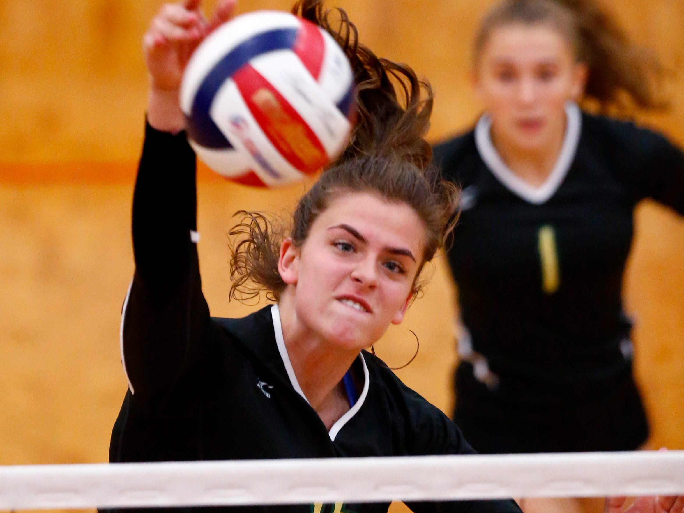 Greenfield's Ratka Karac drives a kill shot at South Milwaukee on Sept. 18.
