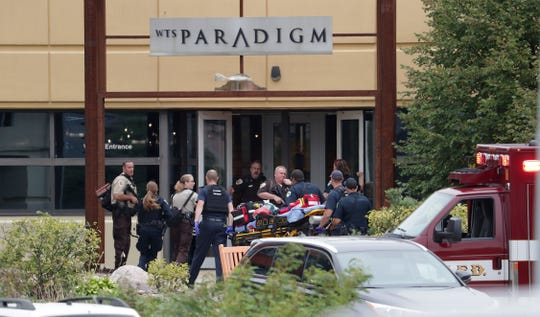 Emergency personnel arrive on the scene of a shooting at a software company in Middleton.  Four people were shot and wounded during the shooting in the suburb of Madison, according to a city administrator.