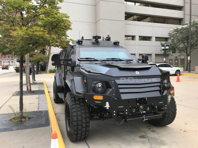 A SWAT team vehicle from the Boulder Colorado police department is parked in front of the Hyatt Hotel as part of an annual law enforcement conference in downtown Milwaukee.