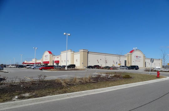 The village of Menomonee Falls and Woodman's have reached a settlement in a lawsuit over the grocery store's appraisal.