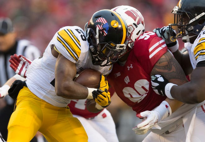 UW nose tackle Olive Sagapolu and the Badgers defense held Iowa to 25 yards rushing on 26 attempts last season.