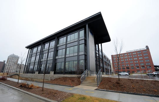 Zurn Industries LLC's headquarters is the only office building developed so far at Reed Street Yards. City officials are endorsing a financing plan for sewer work to accommodate more development there.