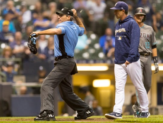 Home plate umpire Angel Hernandez ejects Milwaukee Brewers manager Craig Counsell  during the ninth inning against the Arizona Diamondbacks at Miller Park on May 22.