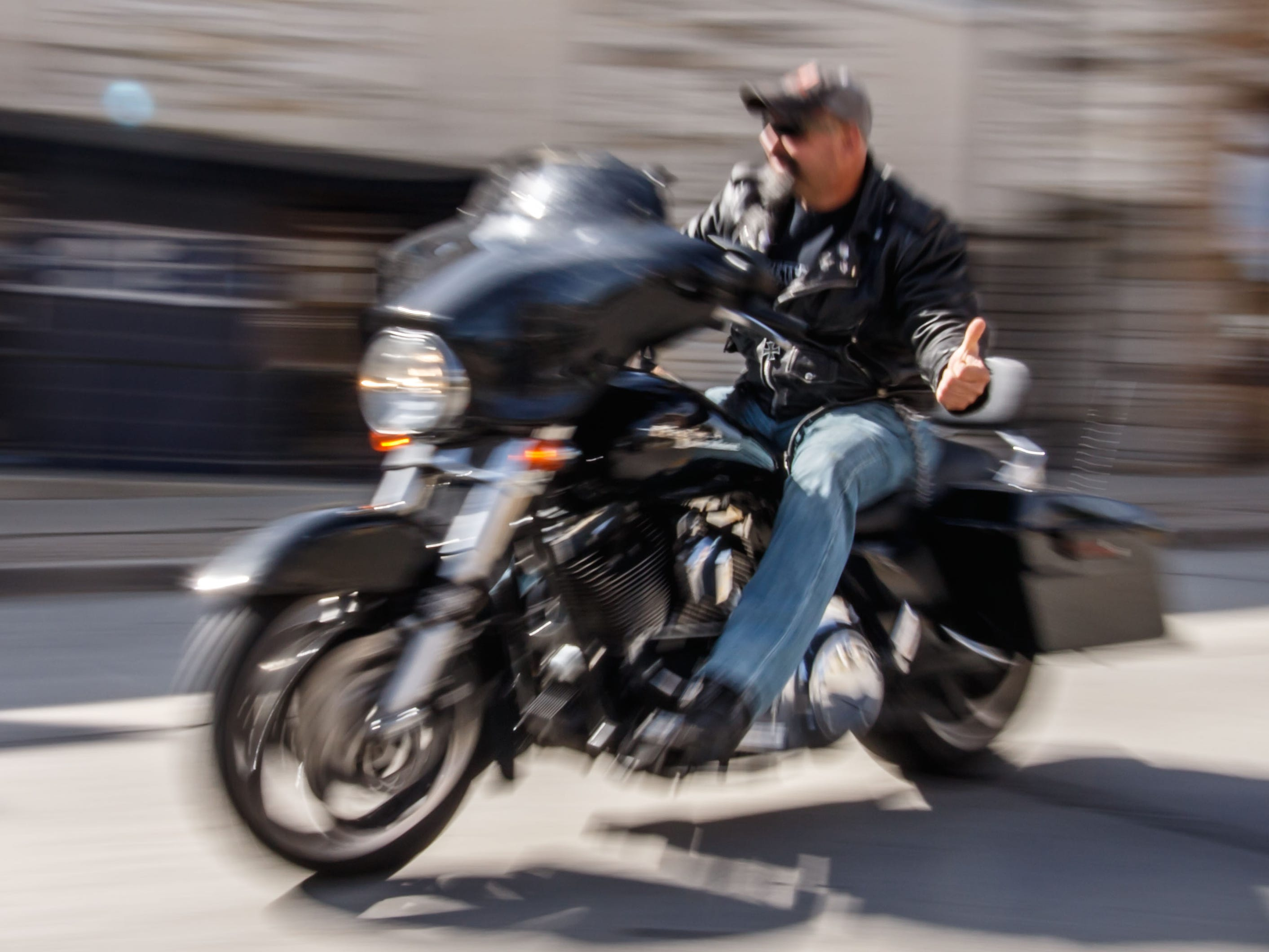 """A motorcyclist departs for the Angels of the Road """"Ride for Veterans"""" inaugural benefit ride hosted by the Henrizi-Schneider American Legion Post 382 in Menomonee Falls on Sunday, Sept. 9, 2018. Proceeds from the ride will benefit the Milwaukee Homeless Veterans Initiative."""