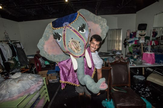 """Danny Mitsios, artistic and executive director for the Montgomery Ballet, with the elephant for this year's production of """"Ballet and the Beasts"""" at the Montgomery Zoo on Friday."""