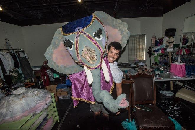 "Danny Mitsios, artistic and executive director of the Montgomery Ballet, with part of the elephant costume used in last year's production of ""Ballet and the Beasts"" at the Montgomery Zoo."