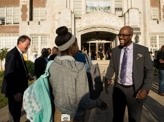 Principal Antonio Williams greets students during the Million Father March event outside Sidney Lanier High School in Montgomery, Ala., on Wednesday, Sept. 19, 2018.