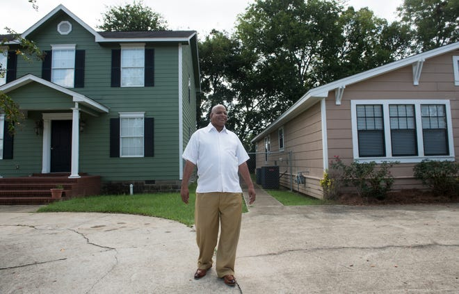 Rev. Willie Welch of First Baptist Church of Greater Washington Park stands in front of houses that he and his church help build in Montgomery, Ala., on Monday, Sept. 10, 2018.