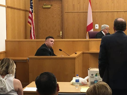 Andrew Bass, seated in witness box, testifies Wednesday afternoon during his manslaughter trial in Wetumpka. Standing is Kenny James, his attorney. Circuit Judge Sibley Reynolds sits on the bench.