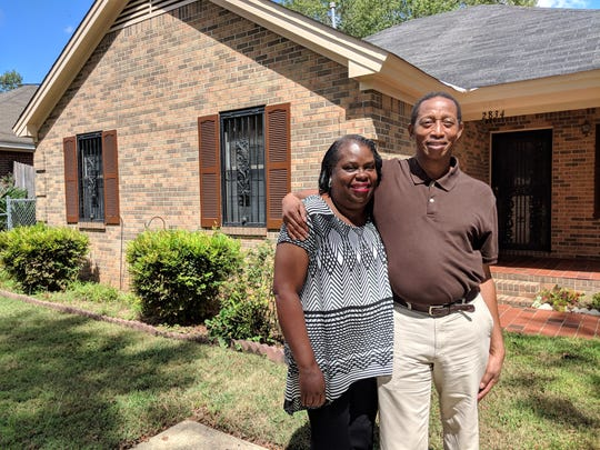 Annie and Sherman Burnett stand in front of their 4th Street home in Greater Washington Park on Sept. 17, 2018.