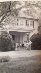 A photo of the Green family outside their Montgomery home on Woodley Road. The fourth of seven, Dot Hawthorne is now 88.