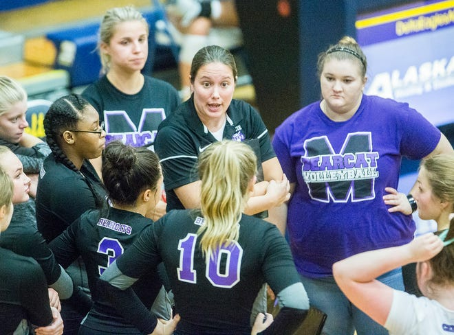 Central coach Kate Hughes talks to the team during a timeout during a match against Delta this season. The Bearcats are 8-19 going into sectional.