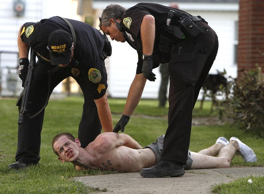 ARCHIVE PHOTO: From 2012: Police arrest Brady Turner after a four-hour stand off at a home at 1428 W. 16th St. in 2012.