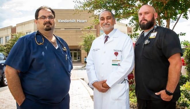Dr. Ahmad Abu-Halimah, Dr. Murali Kolli and Travis Ghee stand outside the Vanderbilt Heart office in Murfreesboro. Ghee was diagnosed with a severe heart condition, and both doctors helped Ghee start the road to recovery. Kolli is now his employer.