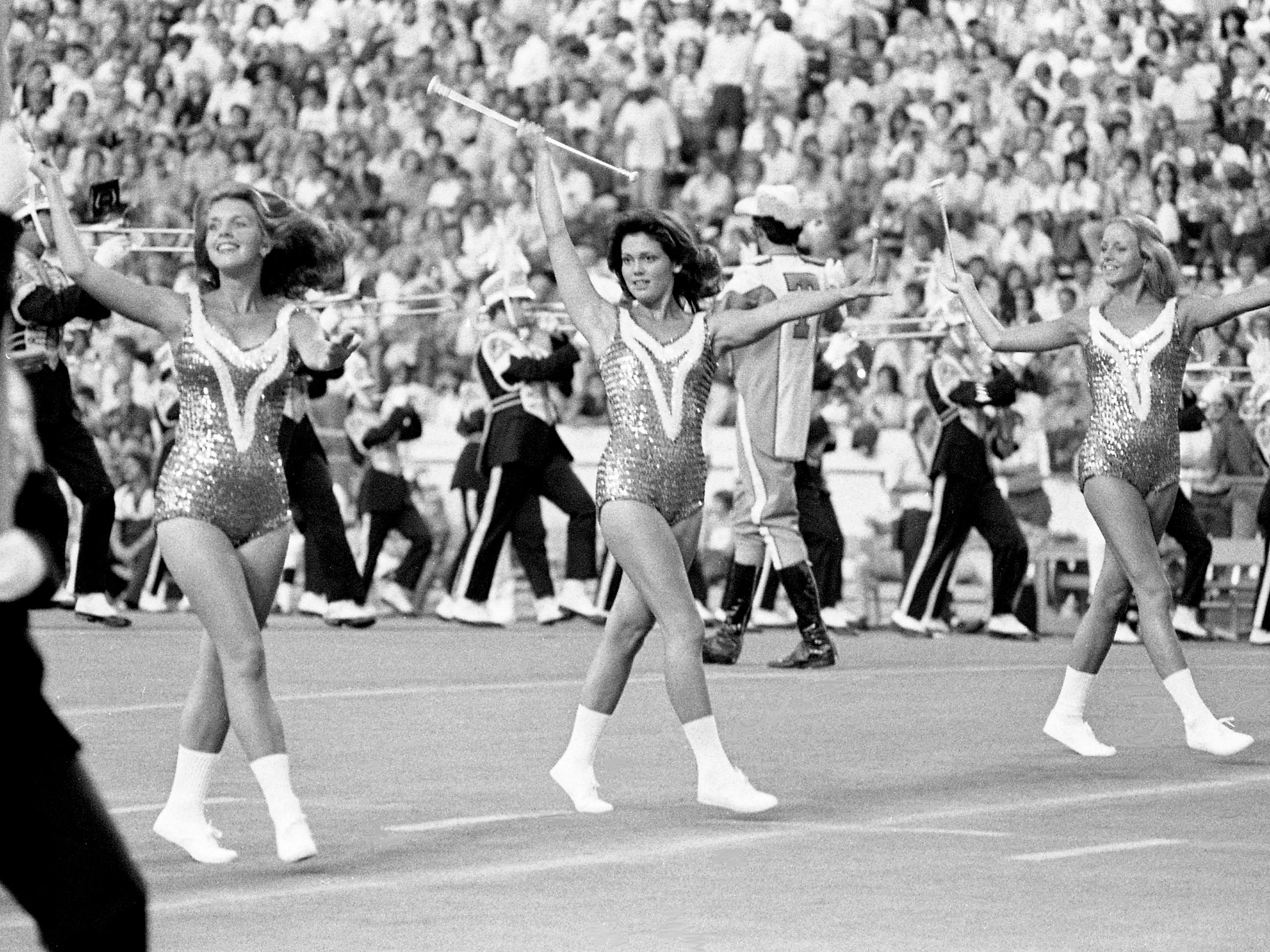 Some of Tennessee majorettes and the Pride of the Southland marching band perform during halftime of the season opener against UCLA. The Vols fall 13-0 to UCLA before an opening record crowd of 85,897 at Neyland Stadium Sept. 16, 1978.