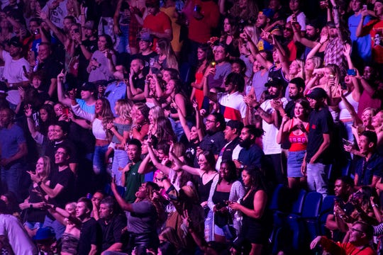 The crowd cheers as Migos opens for Drake at Bridgestone Arena in Nashville on Tuesday, Sept. 18, 2018.