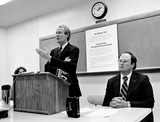 Republican gubernatorial candidate Lamar Alexander, left, with an enlargement of excerpts from financial documents of Democratic opponent Jake Butcher in the background, outlines charges that Butcher has been deceptive about a trust of his holdings during an appearance before Vanderbilt University law students Sept. 19, 1978.