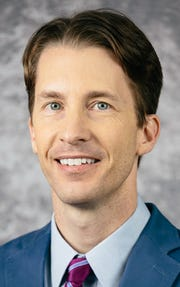 Dustin Smith, M.D., F.A.C.S.