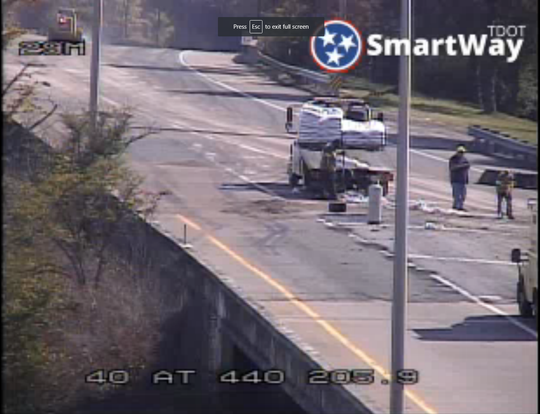 TDOT clean up crews on the scene of a sealant spill on I-440 in Nashville after a commercial truck dropped several hundred gallons of it in an afternoon crash.