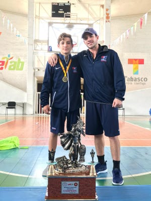 Palmetto Ridge freshman Brennan Van Hoecke, left, along with Team USA coach Chris Ramos, pose for a photo after Van Hoecke won two gold medals at the Pan-American U15 wrestling championships in Mexico City last week.