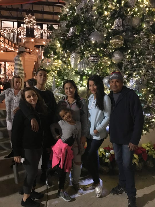 A family photo shows Rubi Velasco Palmer, 18, second from right, who was killed last week in East Naples. A former classmate is charged.