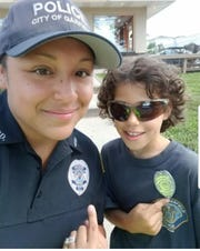 Officer Lopez with Garfield resident Albert Edwards