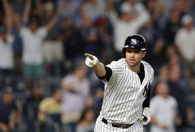 New York Yankees first baseman Neil Walker (14) reacts after hitting a three run home run against the Boston Red Sox during the seventh inning at Yankee Stadium.