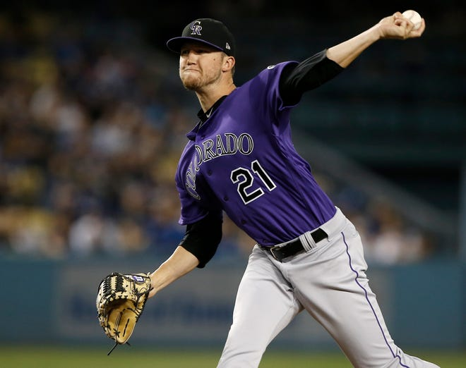 Colorado Rockies starting pitcher Kyle Freeland works to a Los Angeles Dodgers batter during the first inning of a baseball game in Los Angeles, Tuesday, Sept. 18, 2018. (AP Photo/Alex Gallardo)