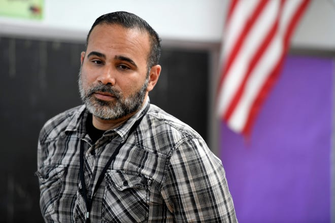 Francisco Gonzalez is one of six Puerto Ricans hired by the Paterson school district to teach in the city. Gonzalez relocated to New Jersey in August after Hurricane Maria. Here, Gonzalez teaches an English as the Second Language (ESL) class in School 5 in Paterson, NJ on Tuesday, September 18, 2018.
