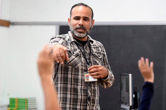 Francisco Gonzalez is one of six Puerto Ricans hired by the Paterson school district to teach in the city. Gonzalez relocated to New Jersey in August after Hurricane Maria flooded his apartment. Here, Gonzalez teaches an English as the Second Language (ESL) class in School 5 in Paterson, NJ on Tuesday, September 18, 2018.