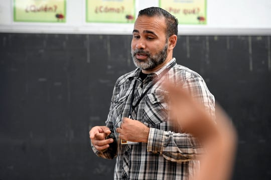 Francisco Gonzalez is one of six Puerto Ricans hired by the Paterson school district to teach in the city. Gonzalez relocated to New Jersey in August after Hurricane Maria flooded his home. Here, Gonzalez teaches an English as the Second Language (ESL) class in School 5 in Paterson, NJ on Tuesday, September 18, 2018.
