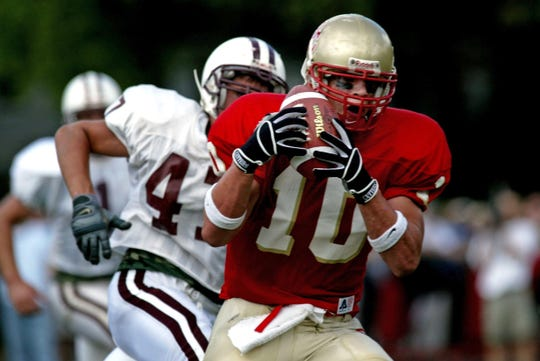 Bergen Catholic#10 Brian Cushing bobbles but catches this pass during a 2003 game.