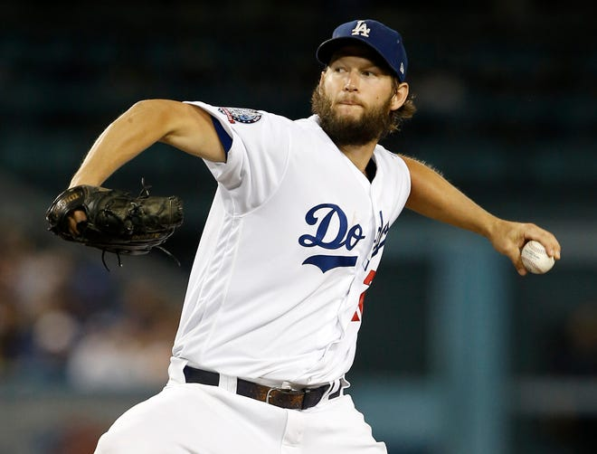 Los Angeles Dodgers starting pitcher Clayton Kershaw delivers to a Colorado Rockies batter during the first inning of a baseball game in Los Angeles, Tuesday, Sept. 18, 2018. (AP Photo/Alex Gallardo)