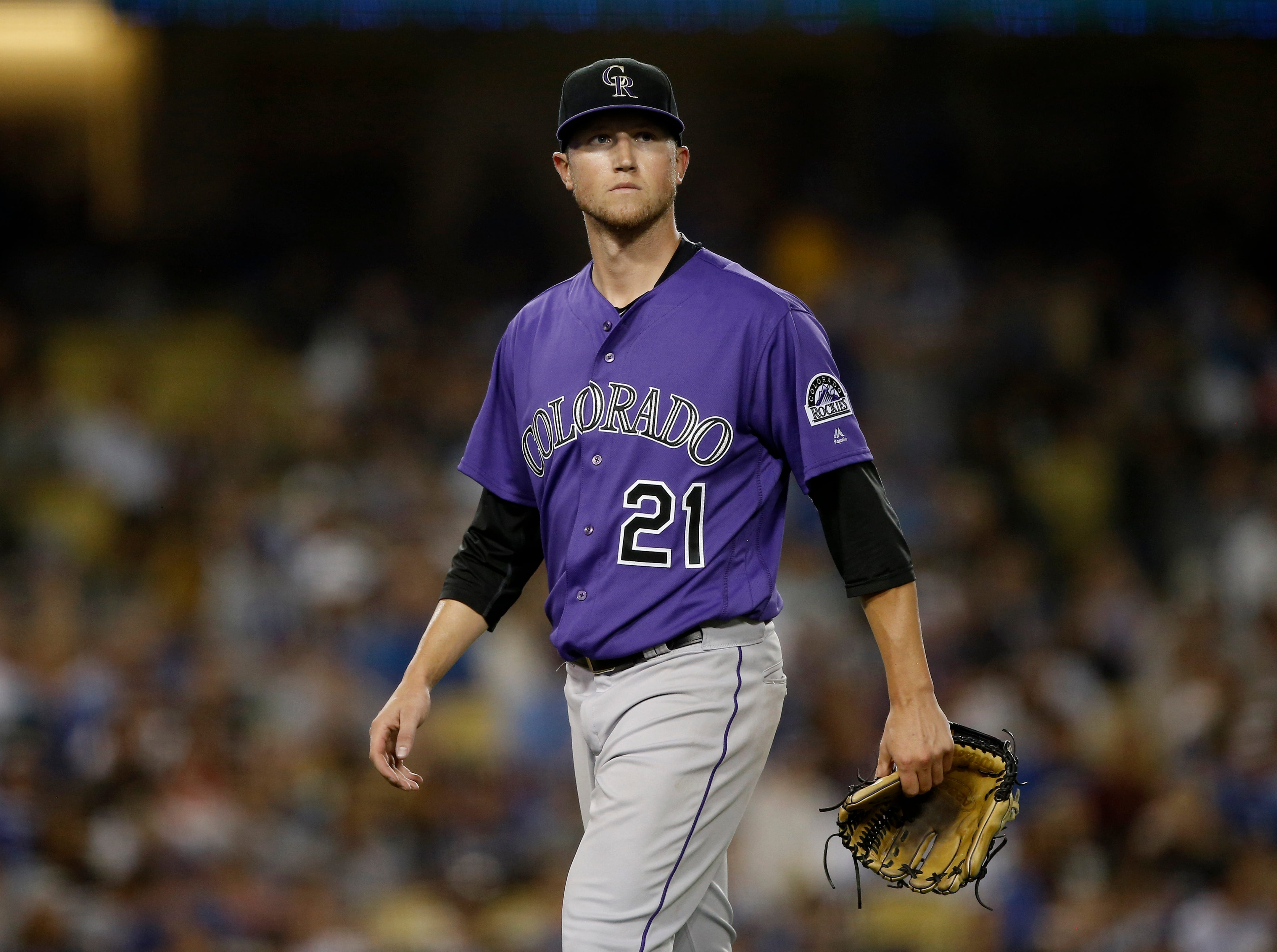 Colorado Rockies starting pitcher Kyle Freeland walks off the field after being pulled by manager Bud Black during the seventh inning of a baseball game against the Los Angeles Dodgers in Los Angeles, Tuesday, Sept. 18, 2018. (AP Photo/Alex Gallardo)