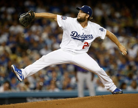 Los Angeles Dodgers starting pitcher Clayton Kershaw throws to a Colorado Rockies batter during the third inning of a baseball game in Los Angeles, Tuesday, Sept. 18, 2018. (AP Photo/Alex Gallardo)