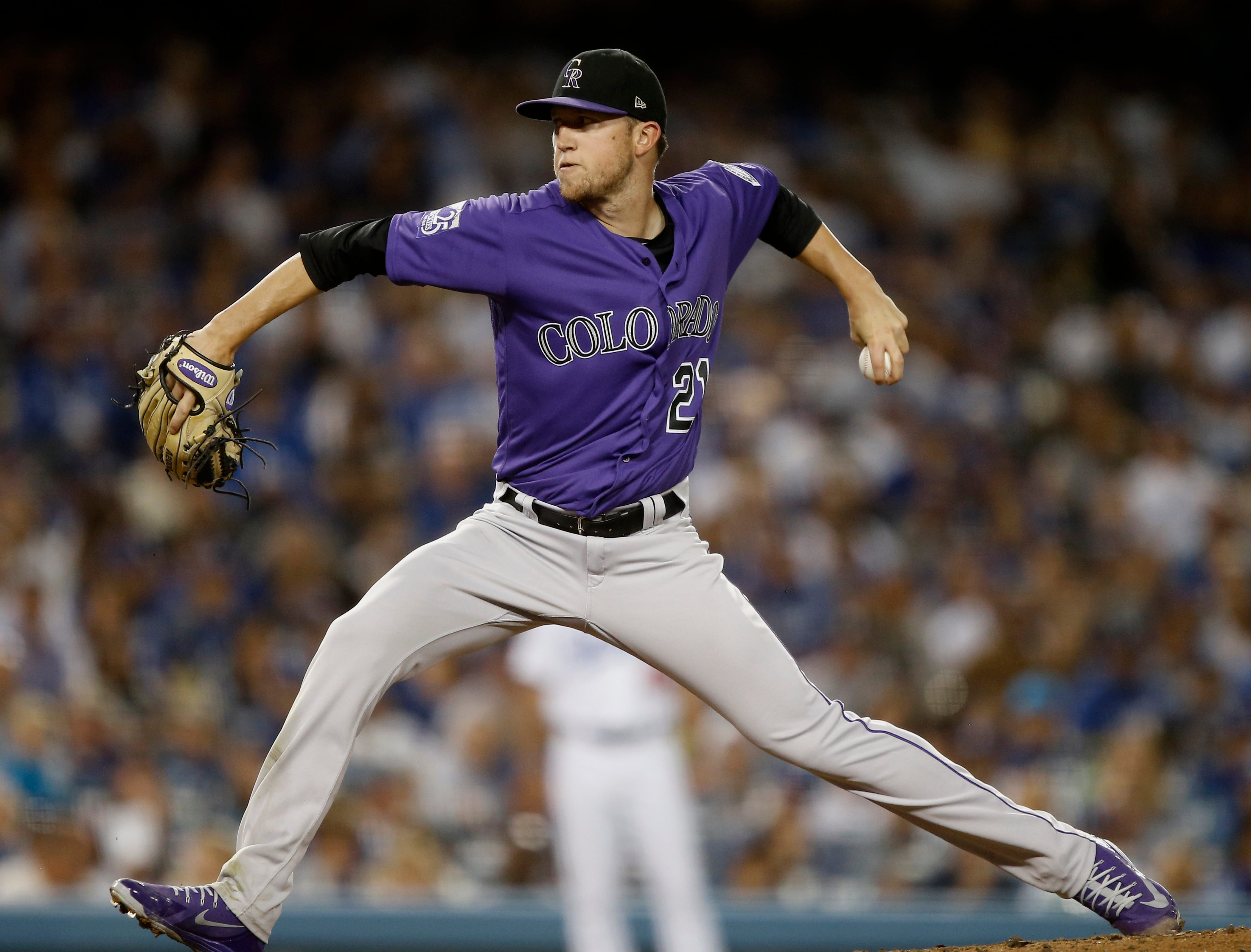 Colorado Rockies starting pitcher Kyle Freeland works to a Los Angeles Dodgers batter during the sixth inning of a baseball game in Los Angeles, Tuesday, Sept. 18, 2018. (AP Photo/Alex Gallardo)