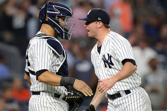 Sep 18, 2018; Bronx, NY, USA; New York Yankees catcher Gary Sanchez (24) and relief pitcher Zach Britton (53) celebrate after defeating the Boston Red Sox at Yankee Stadium.