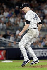New York Yankees starting pitcher J.A. Happ reacts after striking out Boston Red Sox's Brock Holt for the third out in the sixth inning of a baseball game Tuesday, Sept. 18, 2018, in New York.