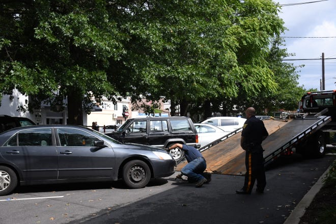 A car at the scene of an attempted break-in being towed away, in Nutley.