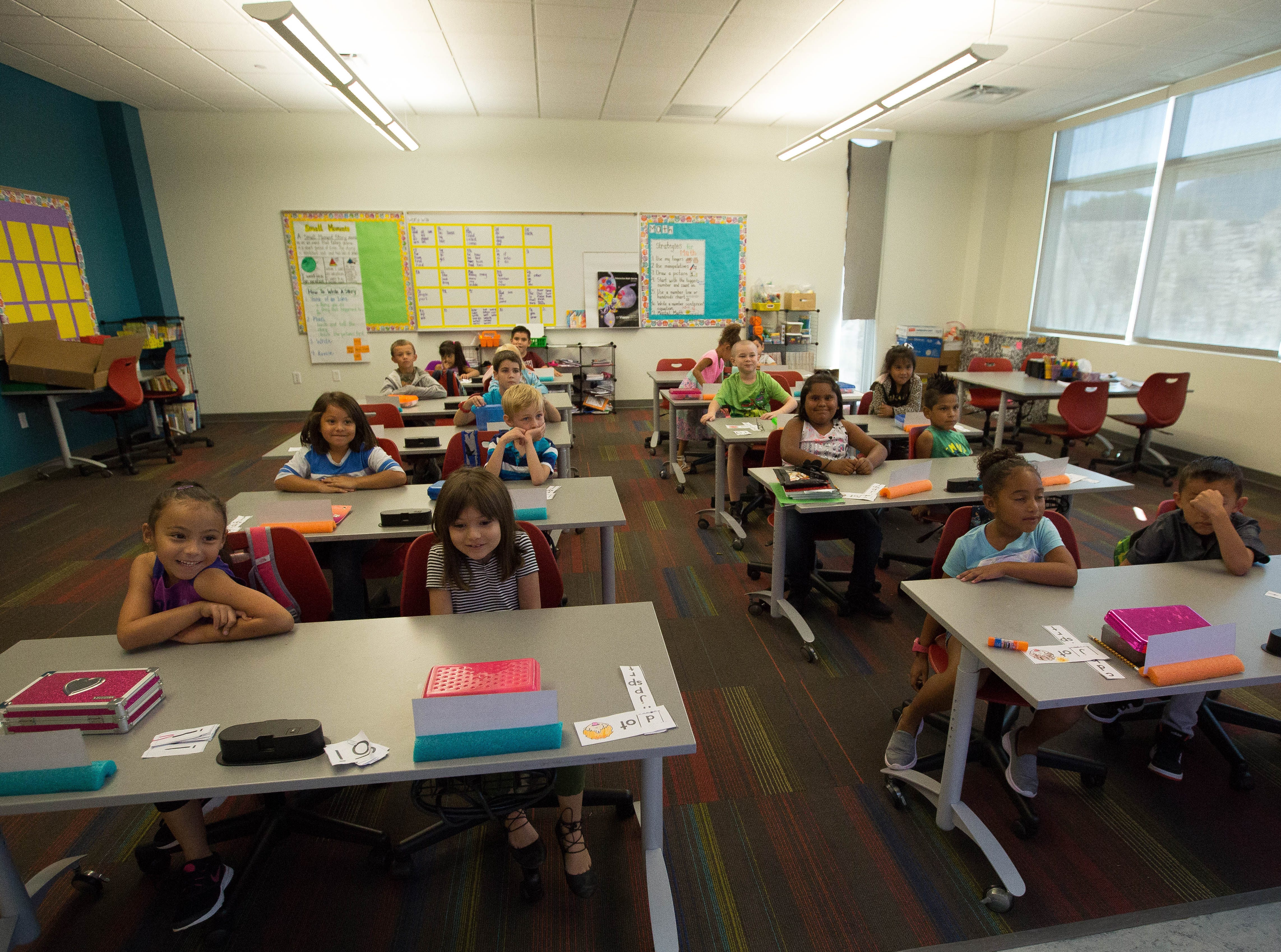 Melissa Madrid's first grade class from Columbia Elementary School watching a video during their school day Wednesday September 19, 2018 at Centennial High School.