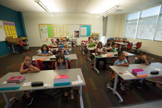 Melissa Madrid's first-grade class from Columbia Elementary School watches a video during their school day Wednesday September 19, 2018 at Centennial High School.