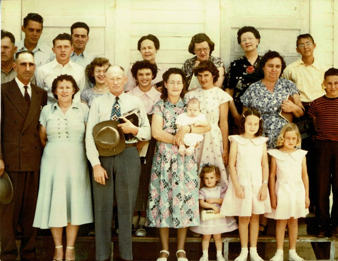 Illinois Camp residents in their Sunday best on schoolhouse steps, ca. 1950s.