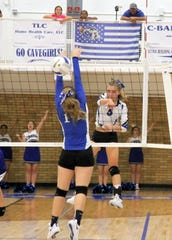 Alexa Sowers spikes the ball during Tuesday's match against Lovington. The Cavegirls won in four sets.