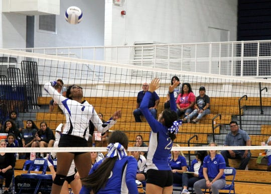 Destiny Young spikes the ball during Tuesday's match against Lovington. The Cavegirls won in four sets.