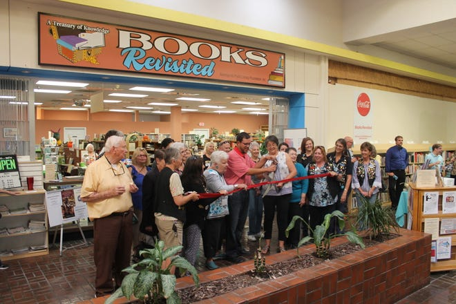 """Books Revisited celebrated its grand reopening on Wednesday in the White Sands Mall. Store volunteers, City officials, the Alamogordo Chamber of Conference, and other well-wishers participated in the ribbon-cutting, which marks the store's seventh year in the mall. According to managers Flori McElderry and Gerrie Bostick, the store boasts """"tens of thousands"""" of books of every kind."""