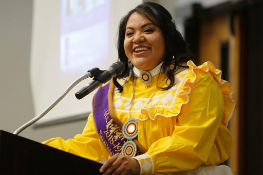 Ms. Indian San Juan College contestant Samantha Ramires talks about ingredients used to make a hominy and pork soup from the Choctaw Nation on Tuesday at San Juan College Henderson Fine Arts Center in Farmington.