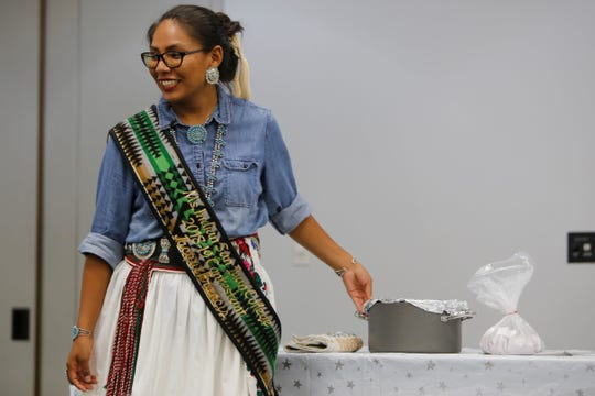 Jacqui Francis answers a question about the blue corn mush she made for the traditional foods demonstration as part of the Ms. Indian San Juan College pageant on Tuesday at San Juan College Henderson Fine Arts Center in Farmington.