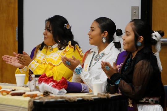 Contestants Samantha Ramires, Charlene Begay and Twyla George, from left, show support for Jacqui Francis during the Ms. Indian San Juan College pageant on Tuesday at San Juan College Henderson Fine Arts Center in Farmington.